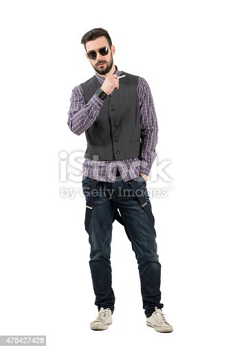 istock Serious young fashion male model smoking cigarette 475427428