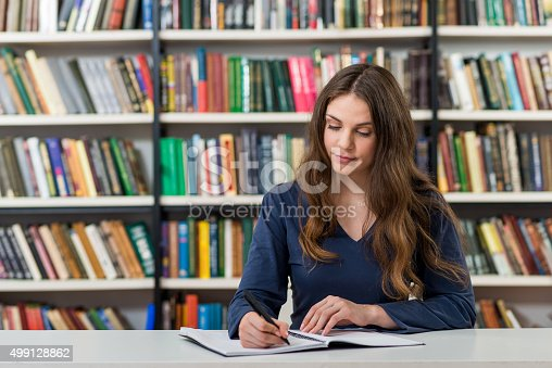 istock serious young girl with loose long dark hair 499128862