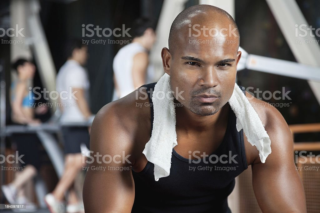 Serious young man at the weight  gym royalty-free stock photo