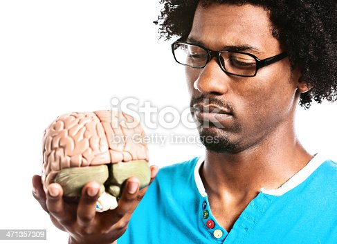 613542420 istock photo Serious young man contemplates scientific model of human brain 471357309