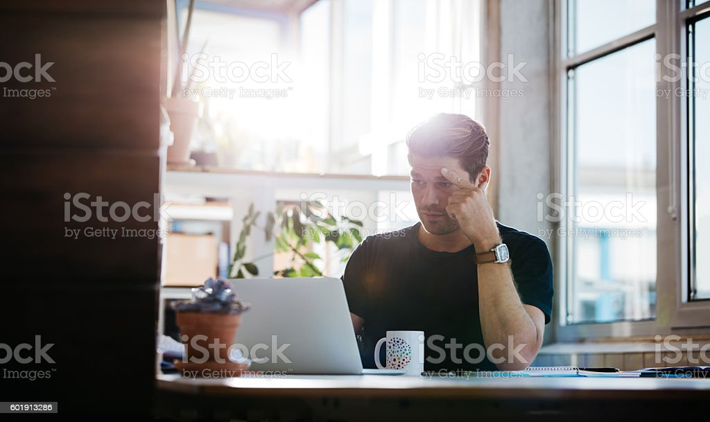 Serious young man finding ideas - Royalty-free Adult Stock Photo