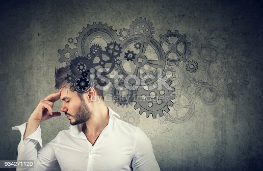 istock Serious young man thinking very hard 934271120