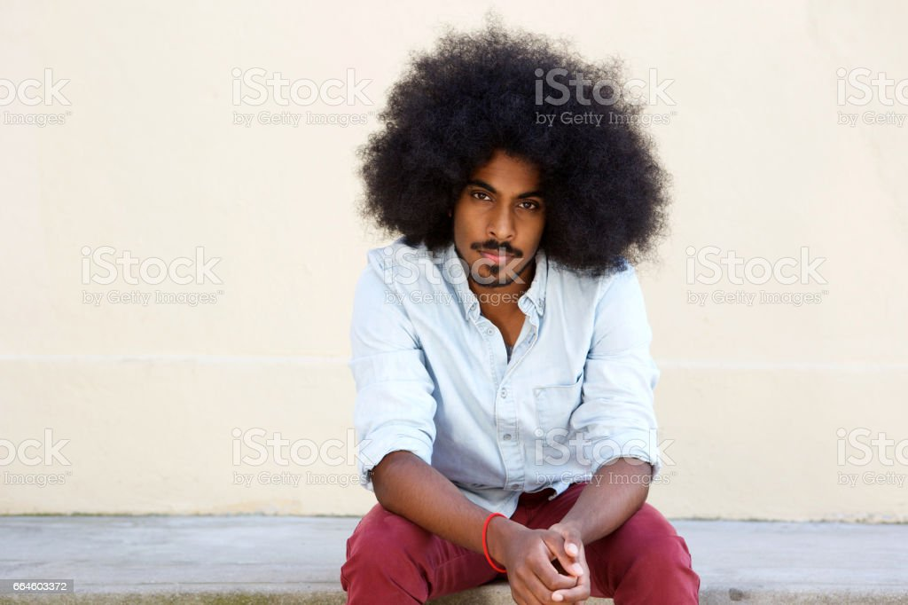 serious young man with afro stock photo