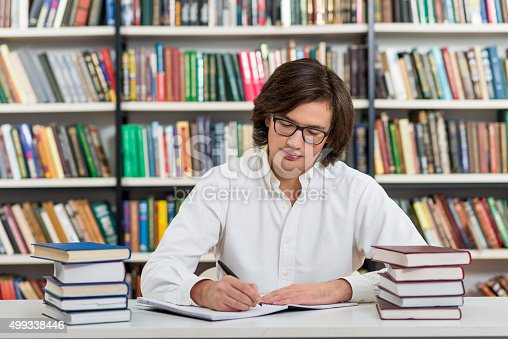 500129038istockphoto serious young man with dark hair 499338446