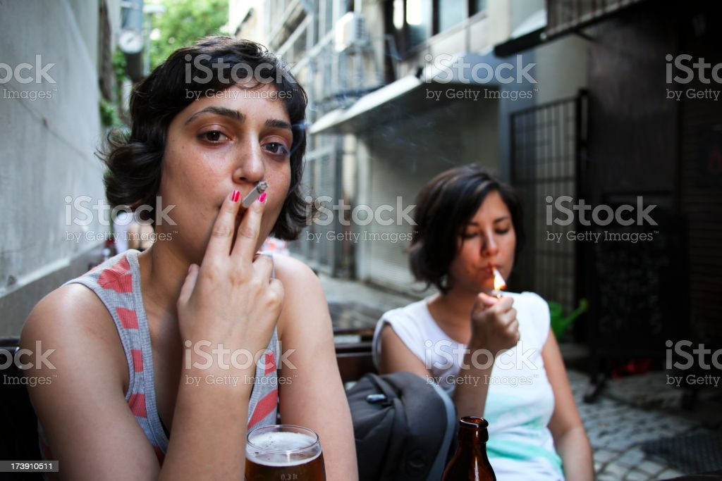 Serious young smokers royalty-free stock photo