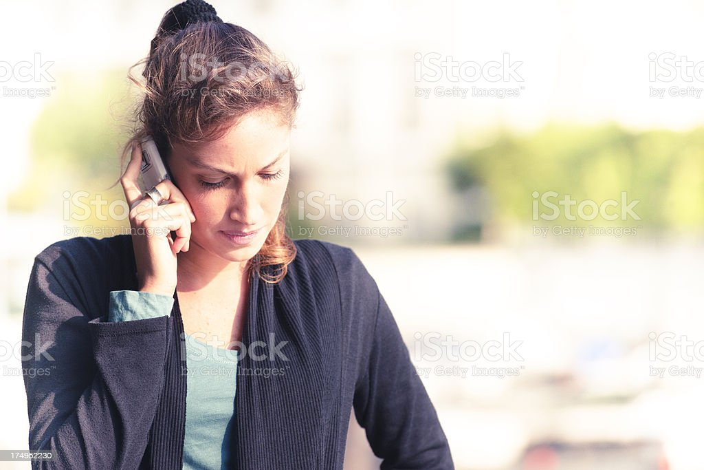 serious young woman calling outdoors royalty-free stock photo