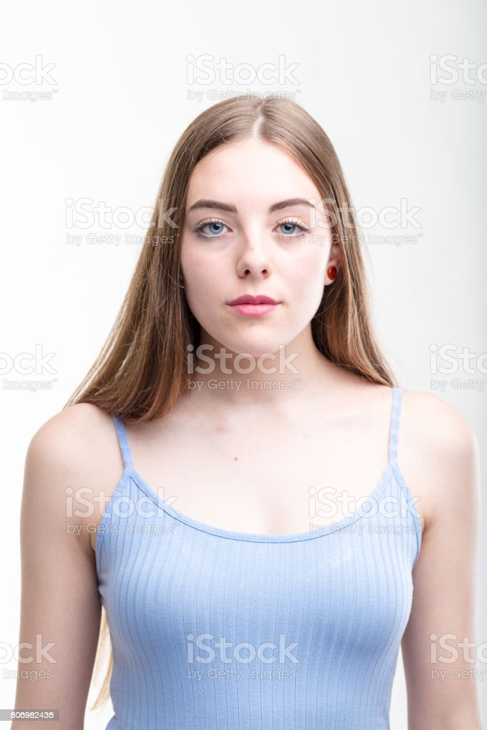 Serious young woman looking intently at camera stock photo