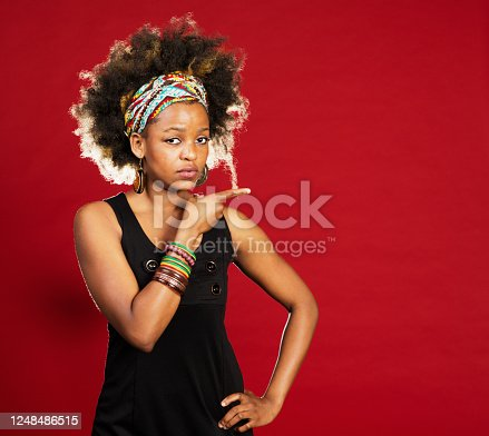 Cute young woman on red background.