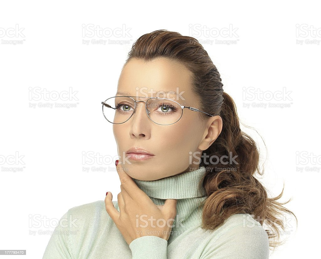 Serious young woman wearing fashion glasses royalty-free stock photo