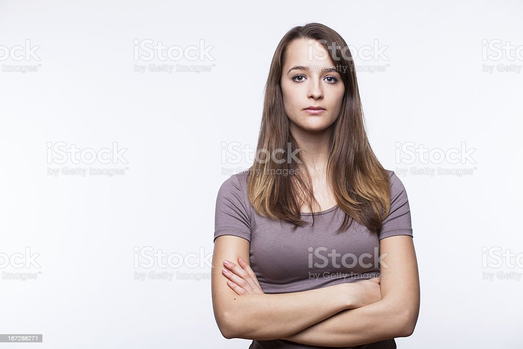 Serious Young Woman With Arms Crossed stock photo