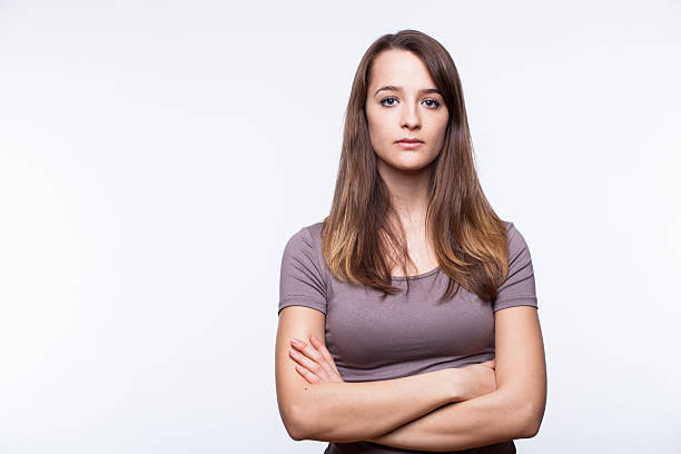 serious young woman with arms crossed - disappointment stock pictures, royalty-free photos & images