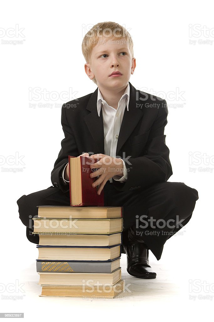 Seriousboy with the book in hands. royalty-free stock photo