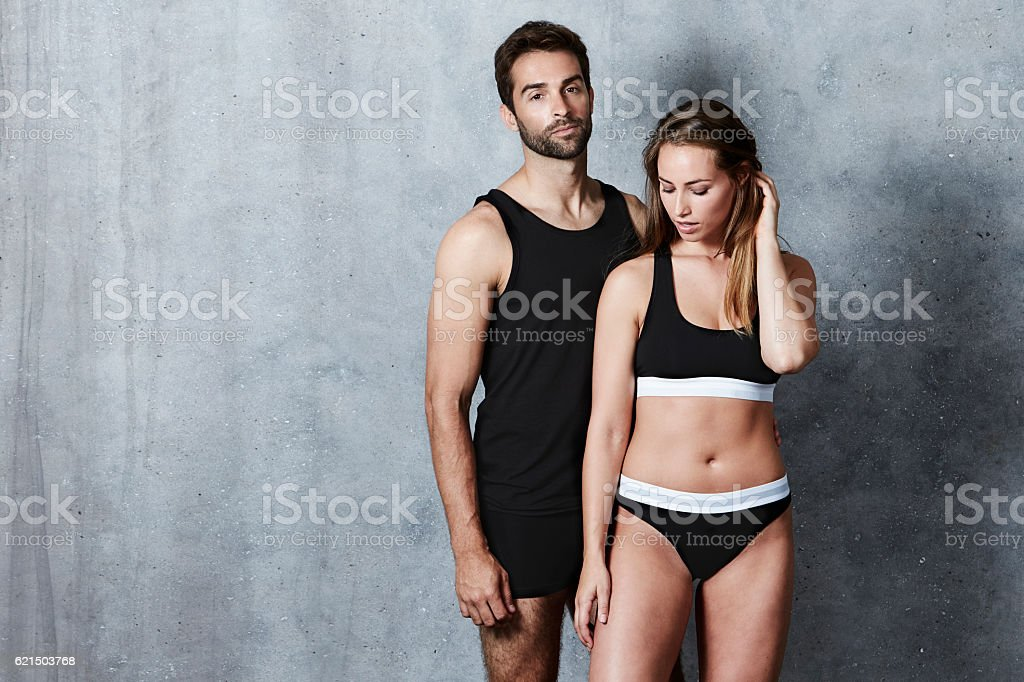 Seriously couple posing in underwear, studio foto stock royalty-free