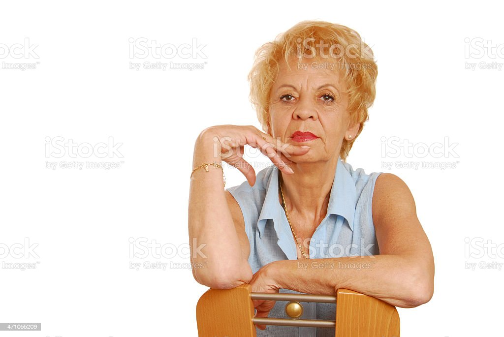 Seriously granny on the chair royalty-free stock photo