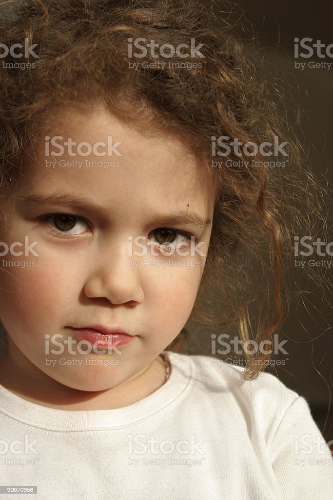 seriously looking little girl stock photo