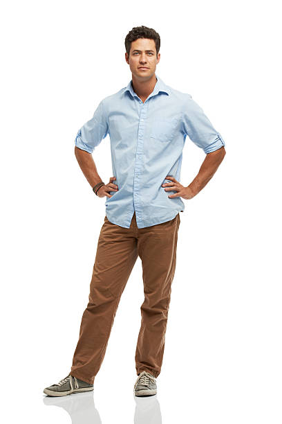 Seriously trendy Full length portrait of a young handsome man isolated on a white background akimbo stock pictures, royalty-free photos & images