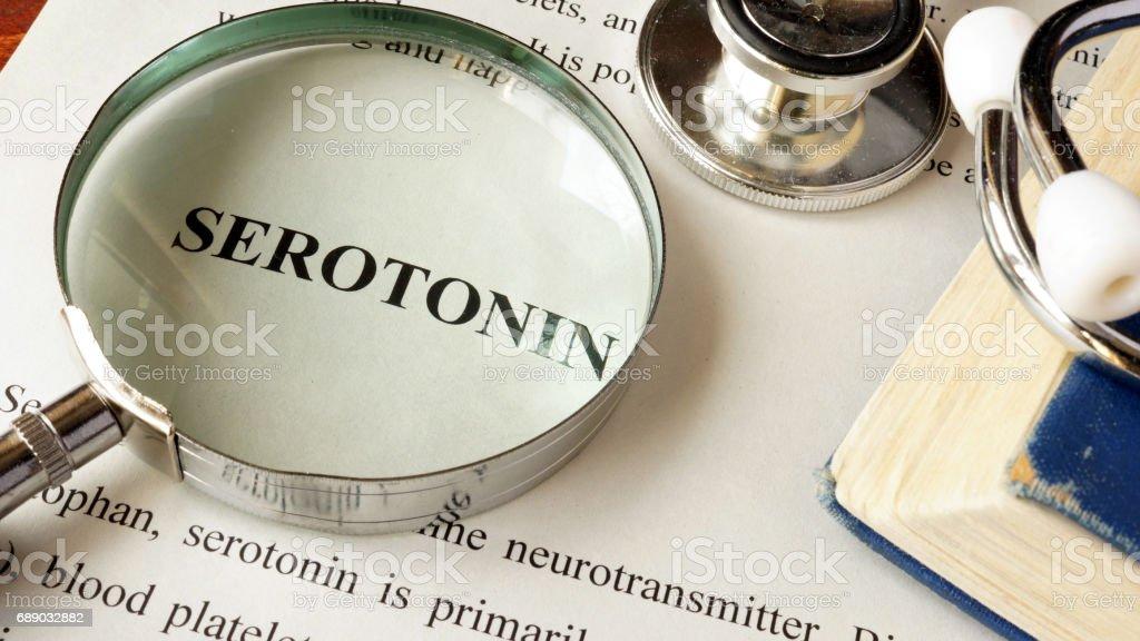 Serotonin written on a page. Human hormones. stock photo