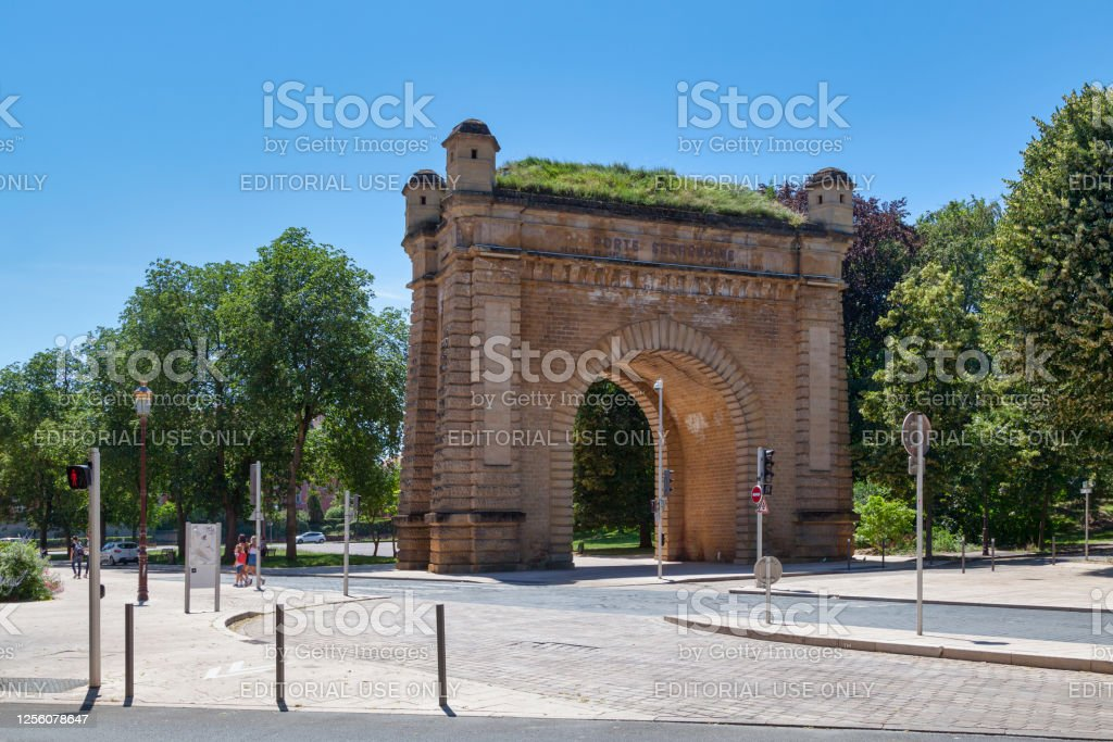 Serpenoise Gate in Metz Metz, France - June 24 2020: The Serpenoise Gate (French: Porte Serpenoise) is a historic, arched city gate on the edge of a park featuring inscriptions, 4 turrets & a grassy top. Architecture Stock Photo