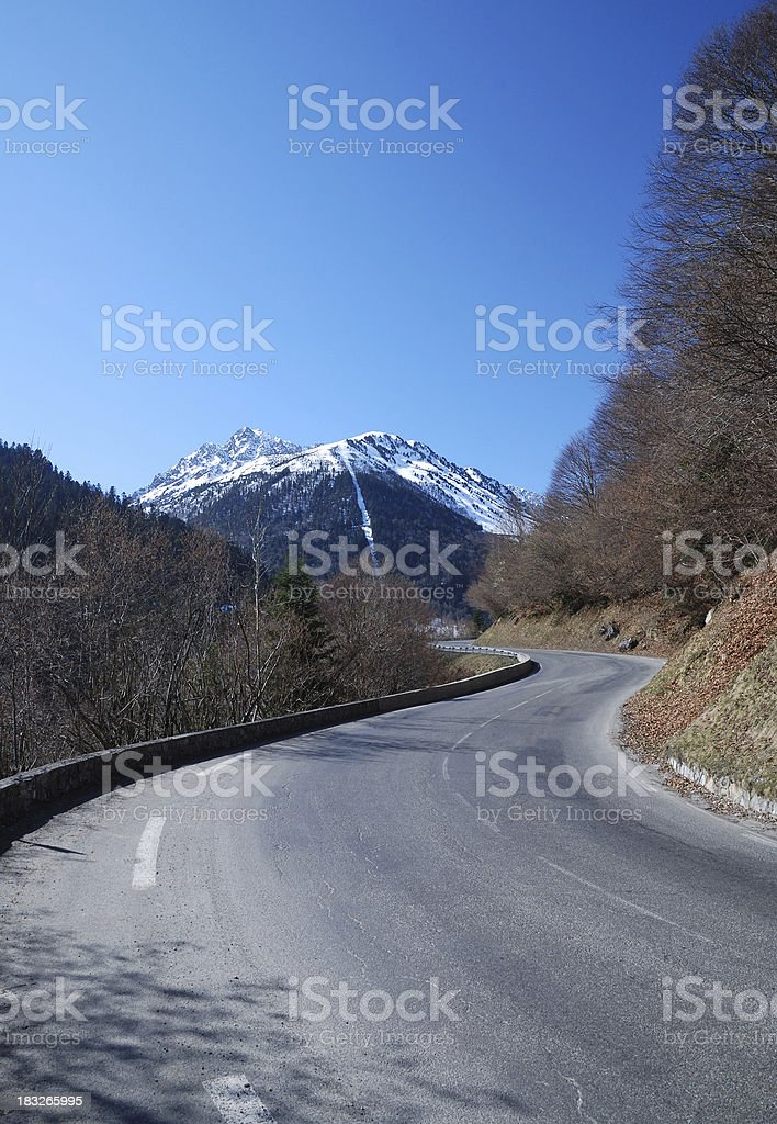 Serpentine road in spring Pyrenees stock photo