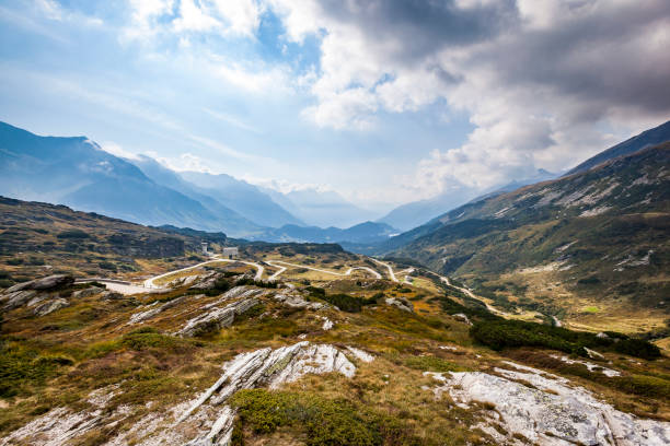 serpentine road to the san bernardino pass, switzerland beautiful mountainscape with serpentine road of san bernardino pass, switzerland. san bernardino california stock pictures, royalty-free photos & images