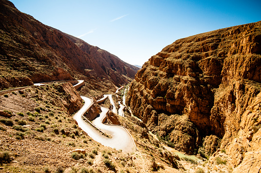 istock Serpentine street by Dades valley in Morocco 825447388