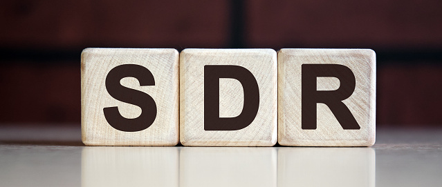 istock SDR Serpstat Domain Rank - concept on wooden cubes on a dark brick background 1221997085