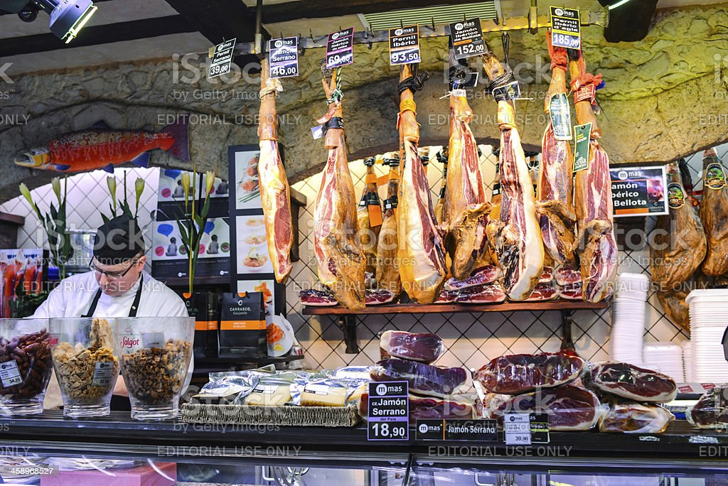 Serrano Ham for sale at La Boqueria Food Market, Barcelona royalty-free stock photo