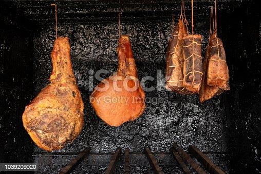 View of serrano ham and pork in a artisanal smokehouse