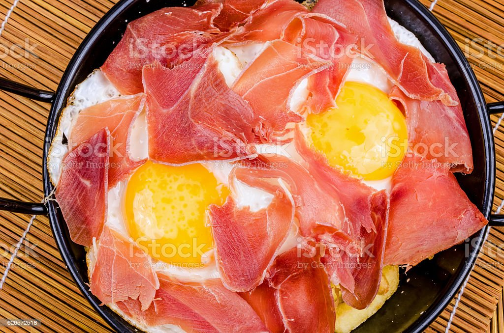 Serrano ham with eggs stock photo