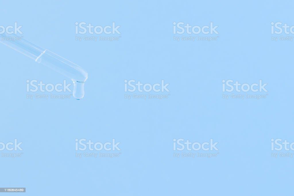 Serum for cosmetic procedures. Serum on a blue background. Cosmetic...