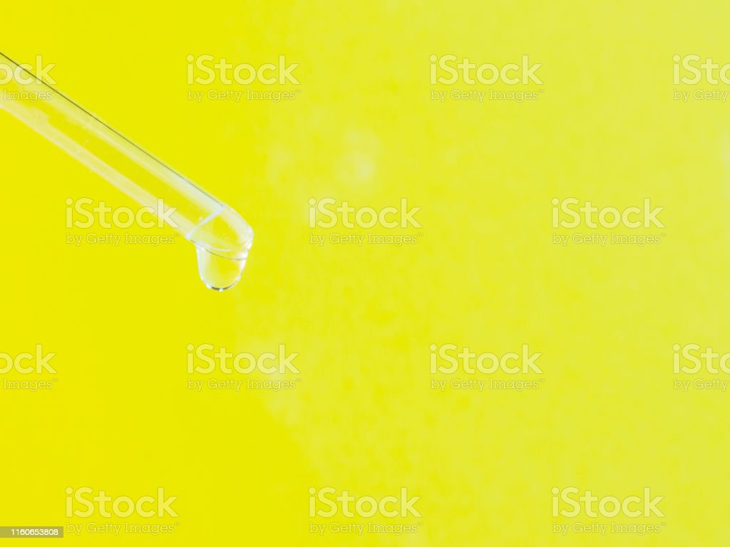 Serum for cosmetic procedures. Serum on a yellow background. Cosmetic...