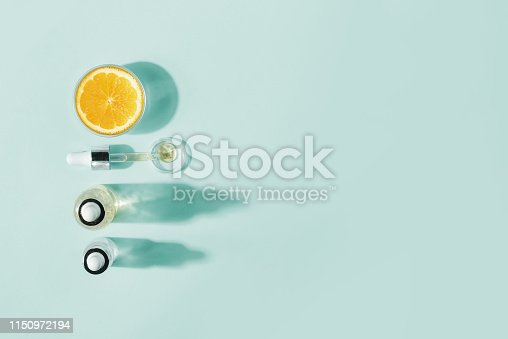 istock Serum with vitamin C, concept design. Beauty therapy, body care. Minimalism Flat lay. 1150972194