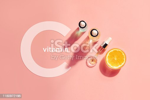 istock Serum with vitamin C, concept design. Beauty therapy, body care. Minimalism Flat lay. 1150972195