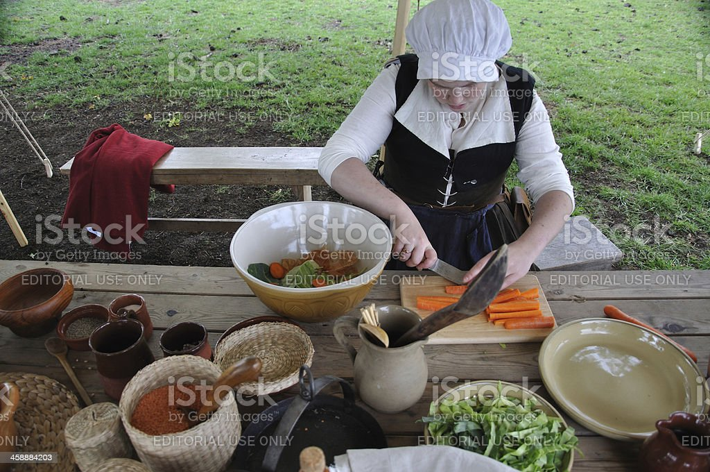 Servant preparing vegtables royalty-free stock photo