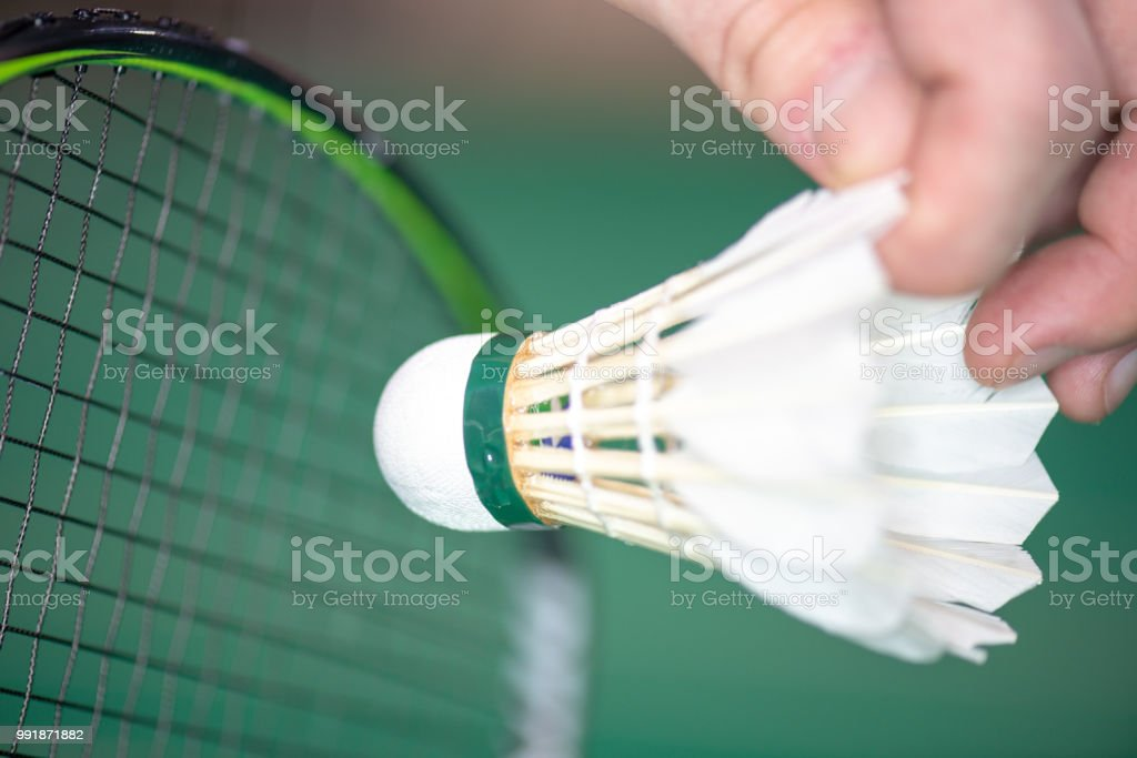 serve badminton with a shuttlecock стоковое фото
