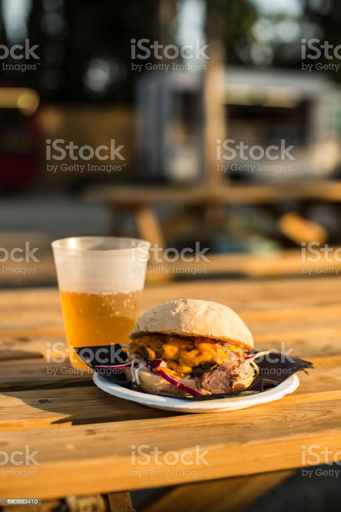 Served burger on plate with beer royalty-free stock photo