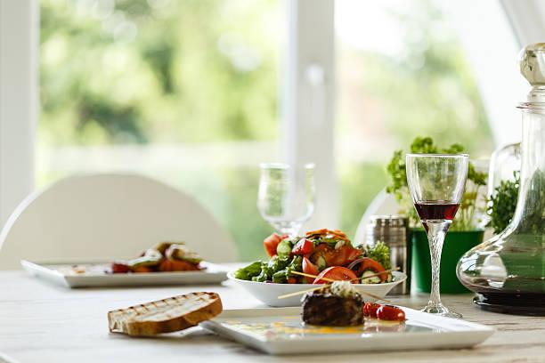 served food on the table - spieltag vorspeisen stock-fotos und bilder