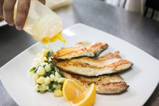 served roasted trout with side dish - trout foto e immagini stock