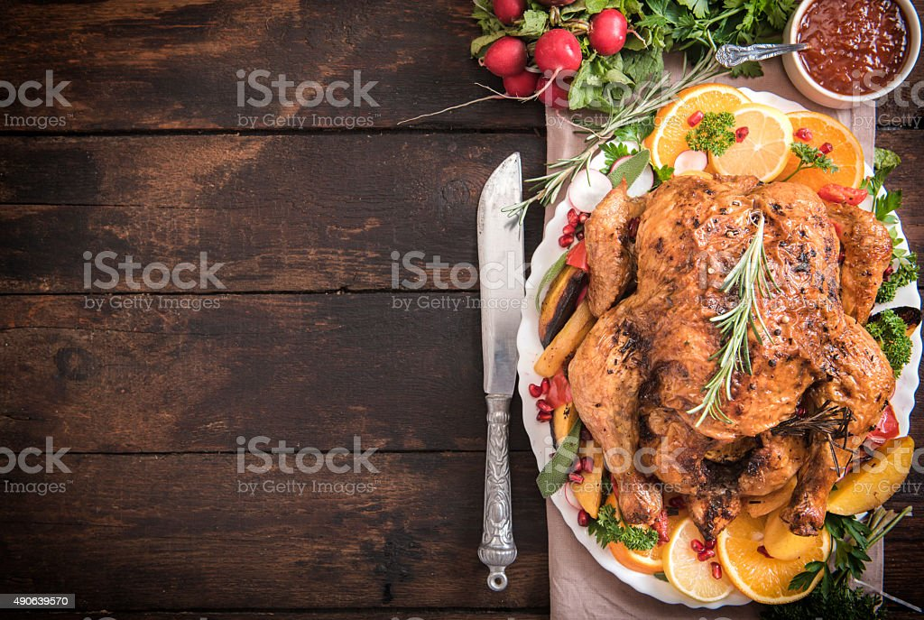 Served roasted turkey with vegetables stock photo