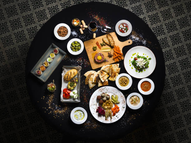 served round table, turkish and buckwheat dishes served table top view. - spanish food stock photos and pictures
