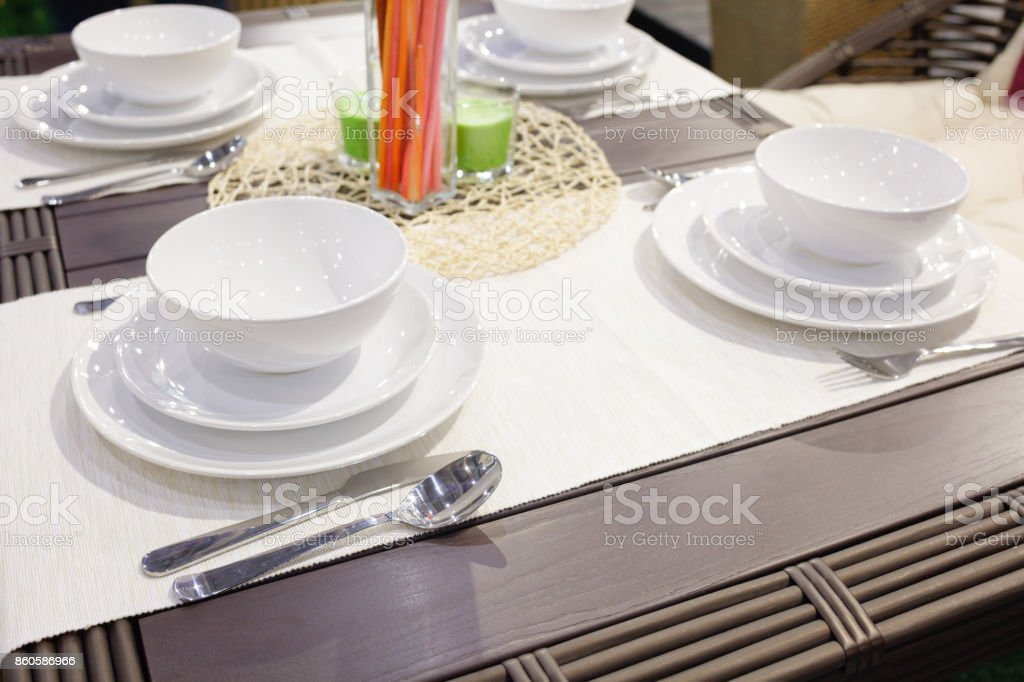 Served table for 4 persons stock photo