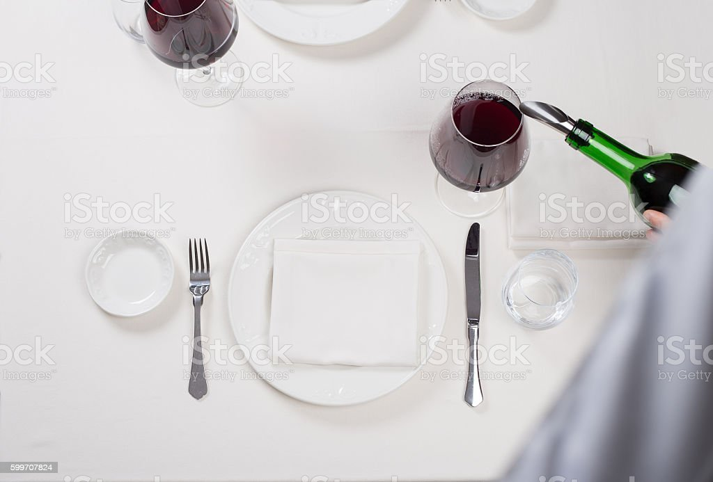 served table restaurant wine being poured into glass stock photo