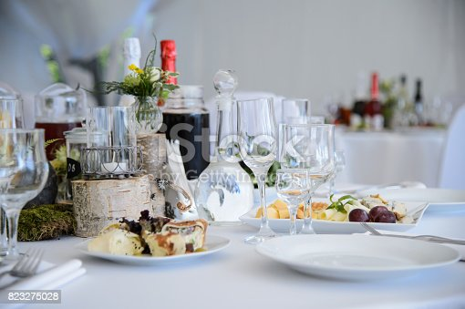 Festive table with food and champagne in the Banquet hall. The celebration of luxury. Dinner party.