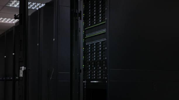 Server and disk storage in dark data center stock photo