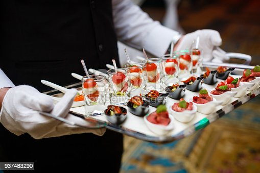 istock Server holding a tray of appetizers at a banquet 937483290