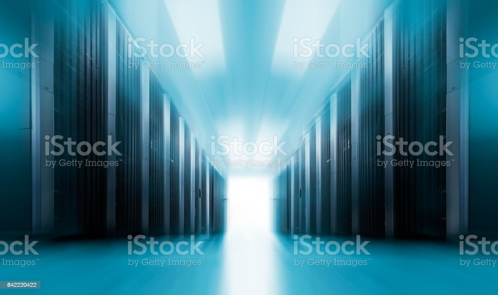 server room data center with rows of supercomputers . The concept of motion blur. stock photo