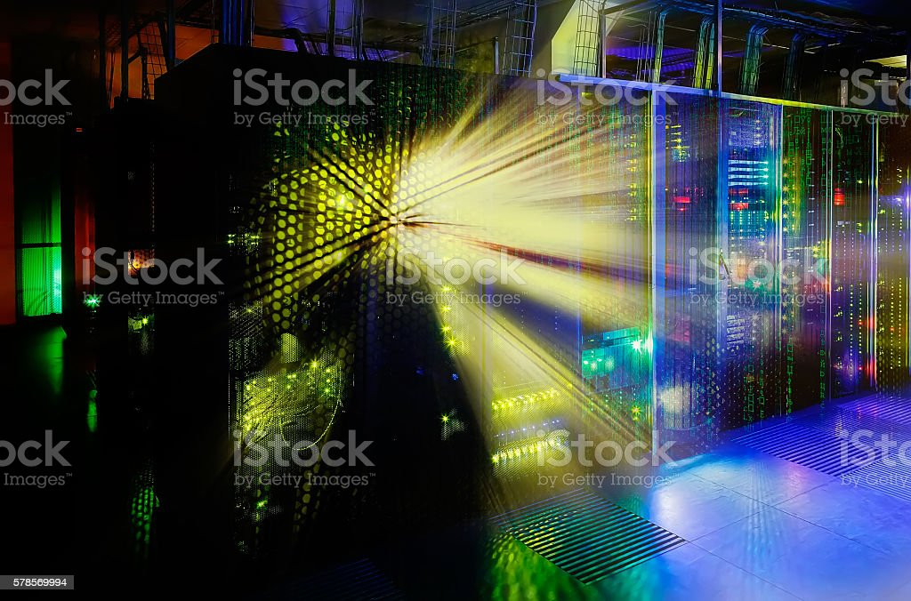 server room in the dark, with bright colored lights stock photo