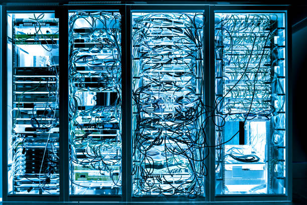 Server room Internet connected servers with multi cables stock photo
