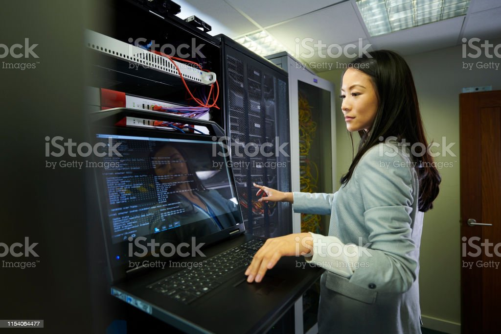 server room Tech young IT professional portrait in a server room 20-29 Years Stock Photo