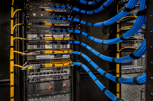 Fiber Optic and Cat 6 wiring in a server room.